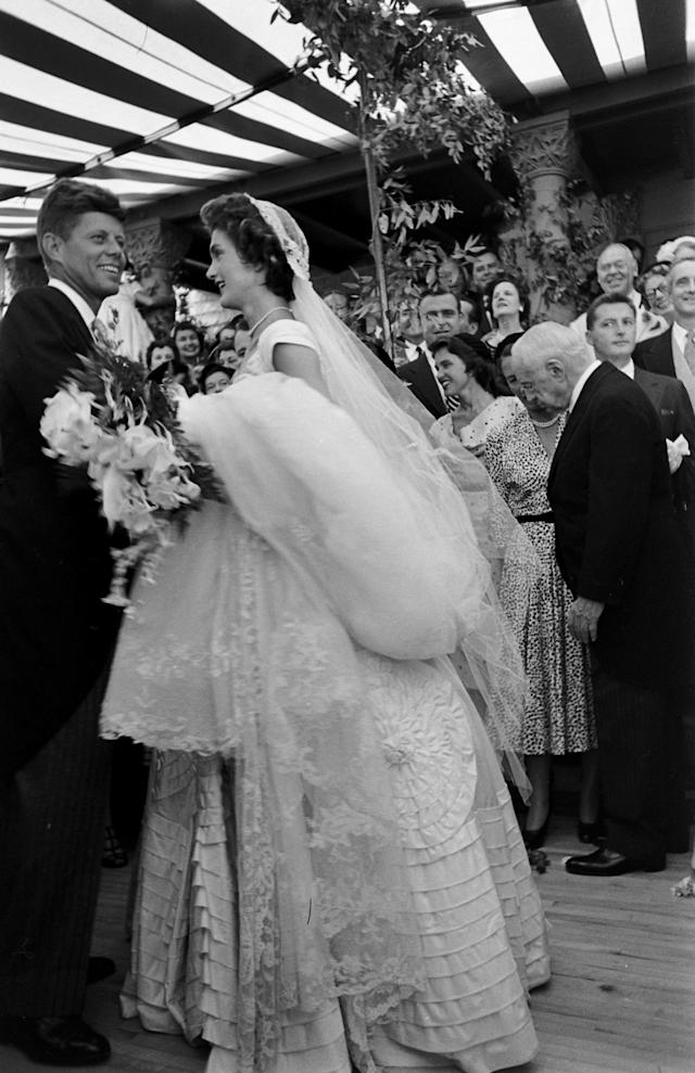 Future US President John F Kennedy (1917 - 1963) and Jacqueline Kennedy (1929 - 1994) (in a Battenburg wedding dress) take the first dance at their wedding reception, Newport, Rhode Island, September 12, 1953. (Photo by Lisa Larsen/Time & Life Pictures/Getty Images)