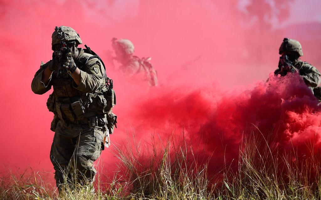 <p>U.S Army soldiers from Apache Company 235 Inf. 25th Infantry Division assault an urban complex during Exercise Southern Jackaro in Townsville, Australia. Exercise Southern Jackaroo is an annual training event involving US Marines, US Army, Japanese Ground Self Defence Force and Australian troops. (Ian Hitchcock/Getty Images) </p>