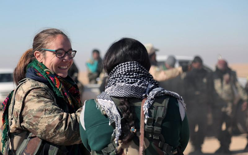 A volunteer British fighter talks with Syrian Democratic Forces (SDF) in the north of Raqqa city - Credit: Reuters