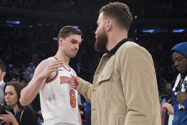 New York Knicks forward Mario Hezonja (8) greets Detroit Pistons forward Blake Griffin at the end of an NBA basketball game Wednesday, April 10, 2019, at Madison Square Garden in New York. The Pistons won 115-89. (AP Photo/Mary Altaffer)