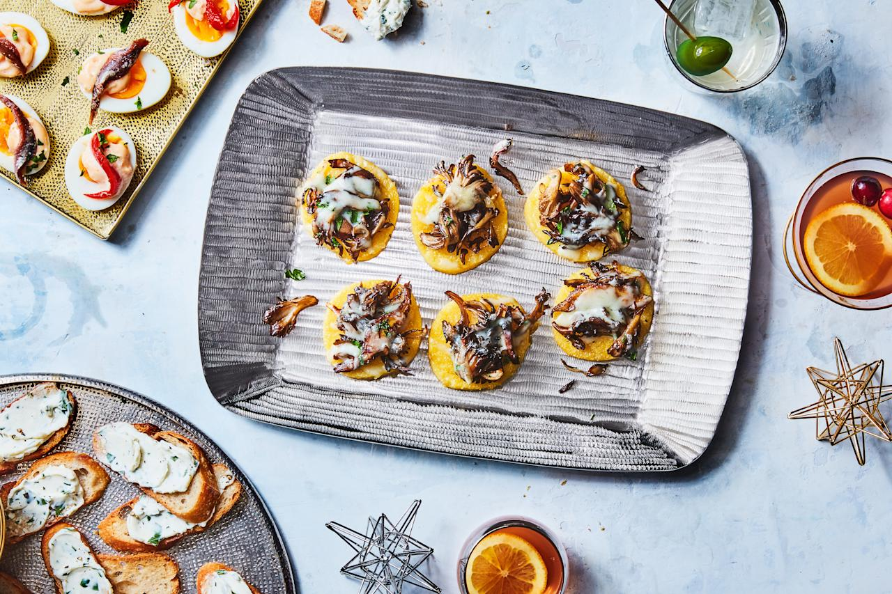 """Store-bought tubes of polenta are the ultimate appetizer shortcut: just slice and toast in the oven, top with wild mushrooms and Fontina, then bake until melty and irresistible. <a href=""""https://www.epicurious.com/recipes/food/views/polenta-bites-with-wild-mushrooms-and-fontina?mbid=synd_yahoo_rss"""">See recipe.</a>"""