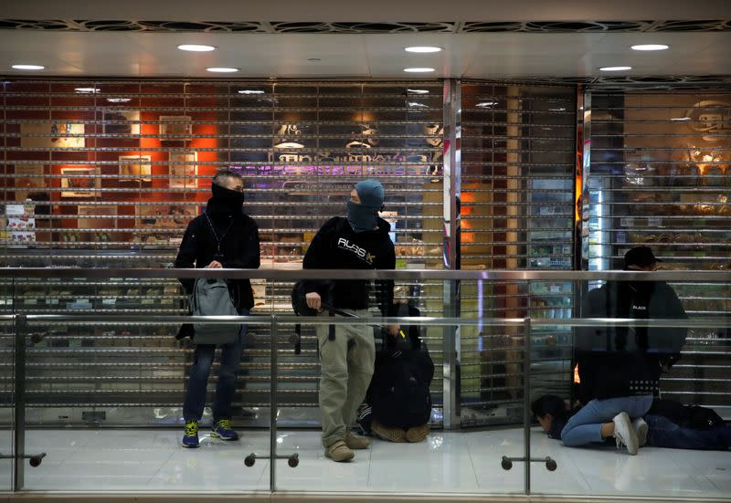 Anti-government protesters are detained inside the Sheung Shui shopping mall in Hong Kong
