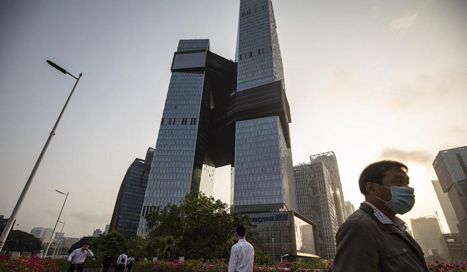 People walk near the Tencent Holdings headquarters in Shenzhen. Guangdong province has tasked the tech hub with building a big data centre for the Greater Bay Area, which includes Hong Kong and Macau. Photo: Bloomberg