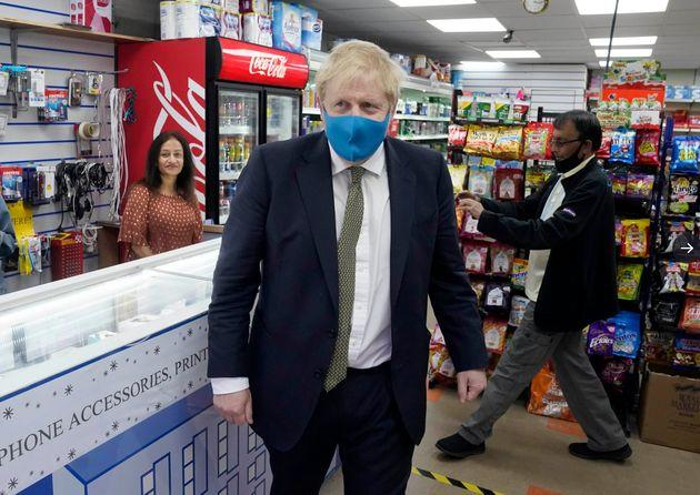The PM in face mask as he visited businesses in Uxbridge on Friday and urged people to
