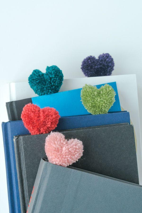 """<p>Friendship bracelets are <em>so</em> elementary. This year, craft these adorable pom-pom bookmark's with your kid for all of her friends. <a href=""""https://www.goodhousekeeping.com/life/entertainment/g1640/book-lovers-quotes/"""" rel=""""nofollow noopener"""" target=""""_blank"""" data-ylk=""""slk:Happy reading!"""" class=""""link rapid-noclick-resp"""">Happy reading!</a></p><p><em><a href=""""https://www.designmom.com/heart-pom-pom-bookmarks/"""" rel=""""nofollow noopener"""" target=""""_blank"""" data-ylk=""""slk:Get the tutorial at Design Mom »"""" class=""""link rapid-noclick-resp"""">Get the tutorial at Design Mom »</a></em> </p>"""