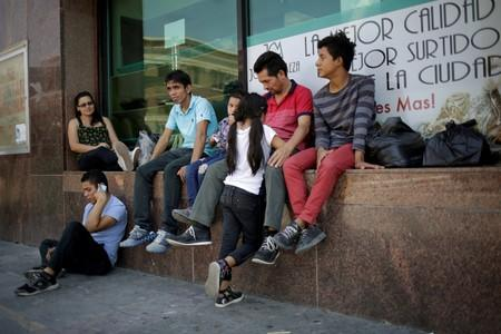 FILE PHOTO: Honduran migrants rest after returning to Mexico from the U.S. under the Migrant Protection Protocol (MPP) to wait for their court hearing for asylum seekers, in Ciudad Juarez