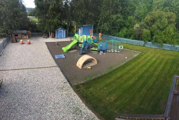 The playground at the Little Blue Early Care & Learning Centre in Dawson City, one of many daycare facilities in the territory that are at maximum capacity. (Little Blue Daycare - image credit)