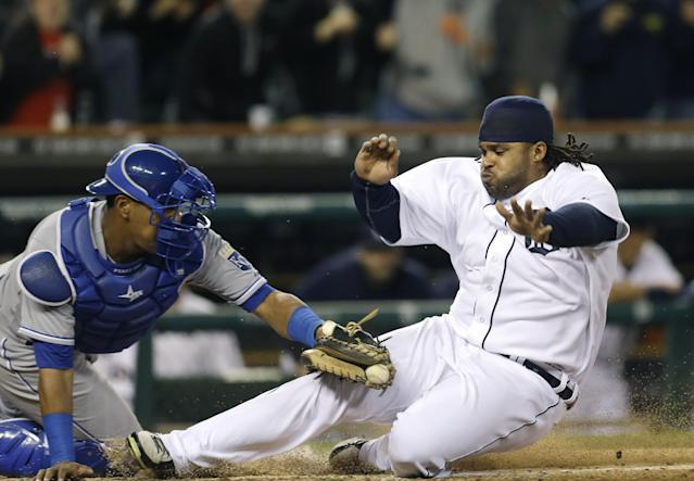 Detroit Tigers' Prince Fielder is tagged out by Kansas City Royals catcher Salvador Perez, left, to end the ninth inning of a baseball game in Detroit, Saturday, Sept. 14, 2013. The Royals won 1-0. (AP Photo/Carlos Osorio)