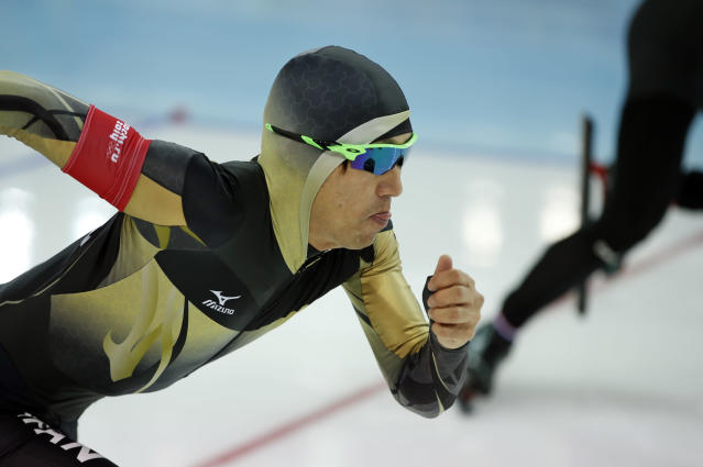 Keiichiro Nagashima of Japan takes the start in the first heat of the men's 500-meter speedskating race at the Adler Arena Skating Center during the 2014 Winter Olympics, Monday, Feb. 10, 2014, in Sochi, Russia. (AP Photo/Pavel Golovkin)