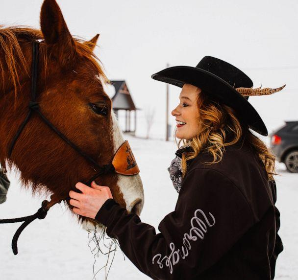 PHOTO: Jaci Hermstad is pictured with her horse, Bud, March 2019, in Webb, Iowa. (Harvest Moon Photography)