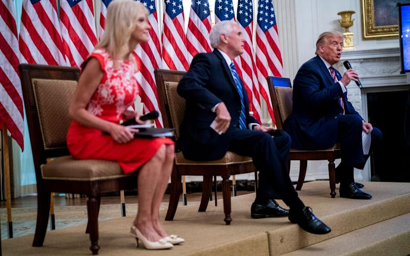 US President Donald J. Trump with Vice President Mike Pence and Kellyanne Conway as they participate in 'Kids First: Getting America's Children Safely Back to School' event in the East Room of the White House - Doug Mills/POOL/EPA-EFE/Shutterstock