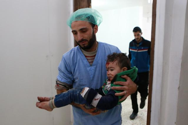 A Syrian child is taken for treatment at a hospital following a reported airstrike in the rebel-controlled town of Arbin, in the eastern Ghouta region on the outskirts of the capital Damascus, on Dec. 3, 2017. (Photo:Abudlmonam Eassa/AFP/Getty Images