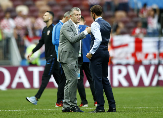 England head coach Gareth Southgate shakes hands with Croatia's soccer legend Davor Suker on the pitch prior the semifinal match between Croatia and England at the 2018 soccer World Cup in the Luzhniki Stadium in, Moscow, Russia, Wednesday, July 11, 2018. (AP Photo/Matthias Schrader)