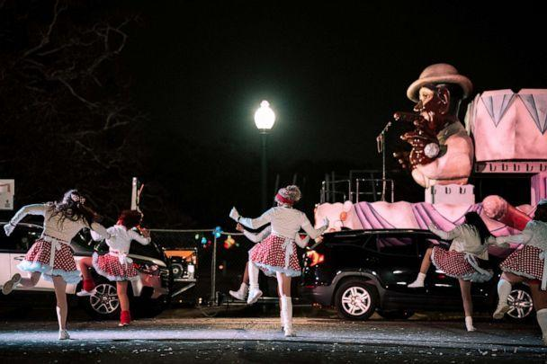 PHOTO: The Mande Milkshakers dance for vehicles driving by during the Mardi Gras Float in the Oaks event in City Park, Feb. 14, 2021, in New Orleans, Louisiana. (Jon Cherry/Getty Images)
