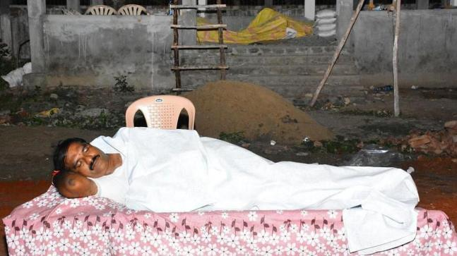 Nimmala Rama Naidu, a state lawmaker from Andhra Pradesh, spent Friday night on a folding cot under the open sky in a mosquito-infested graveyard.