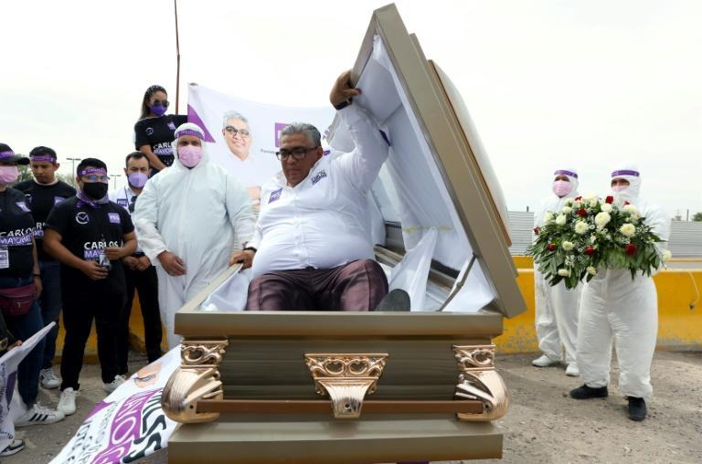 Mexican congressional candidate Carlos Mayorga launches his campaign from inside a coffin to send a message to politicians that people are dying 'because of their indifference'