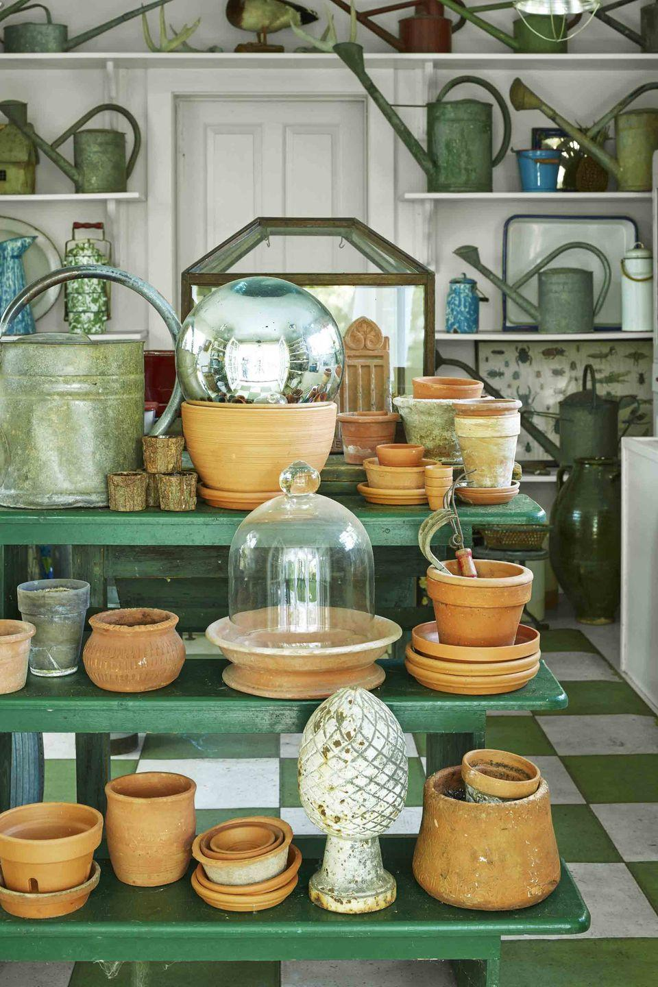 "<p>Seasoned home gardeners know how easy it is for <a href=""https://www.veranda.com/outdoor-garden/g32947916/garden-shed-ideas/"" rel=""nofollow noopener"" target=""_blank"" data-ylk=""slk:potting sheds"" class=""link rapid-noclick-resp"">potting sheds</a> to fall into disarray. <a href=""https://www.veranda.com/outdoor-garden/a32721442/connecticut-garden-bill-reynolds-robb-nestor/"" rel=""nofollow noopener"" target=""_blank"" data-ylk=""slk:Bill Reynolds and Robb Nestor"" class=""link rapid-noclick-resp"">Bill Reynolds and Robb Nestor</a> cleverly divided their utilitarian shed in a gallery-like fashion with specific sections just for pots, cloches, and vintage watering cans. </p>"