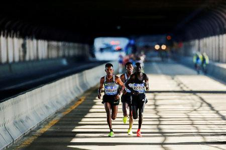 FILE PHOTO: Ghirmay Ghebreslassie (L) of Eritrea leads the men's pack next to Hosea Rotich of Kenya and Lelisa Desisa of Ethiopia as they cross the Ed Koch Queensboro Bridge during the 2016 New York City Marathon in New York City, U.S. November 6, 2016. REUTERS/Eduardo Munoz/File Photo
