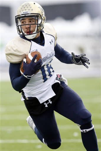 Northern Colorado's Dominic Gunn runs the ball during an NCAA college football game against Weber State in Ogden, Utah, on Saturday, Nov. 10, 2012. (AP Photo/Standard-Exmainer, Kera Williams)