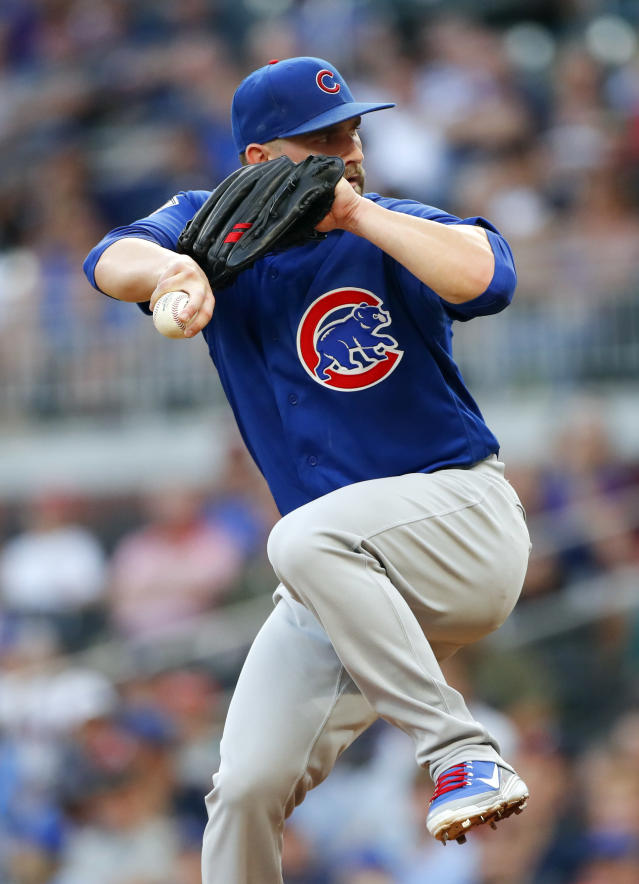 Chicago Cubs starting pitcher Tyler Chatwood winds up during the first inning of the team's baseball game against the Atlanta Braves on Wednesday, May 16, 2018, in Atlanta. (AP Photo/John Bazemore)