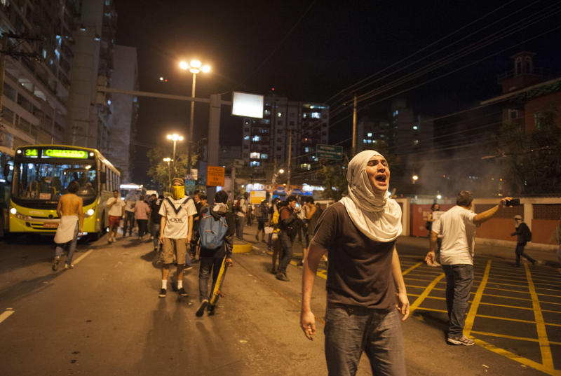 A protestor shouts during an anti-government protest in Rio de Janeiro's sister city, Niteroi, Brazil, Wednesday evening, June 19, 2013. Rio de Janeiro and Sao Paulo city leaders said Wednesday that they reversed an increase in bus and subway fares that ignited anti-government protests. Many people doubted the move would quiet the demonstrations which have moved well beyond outrage over the fare hikes into communal cries against poor public services. (AP Photo/Nicolas Tanner)