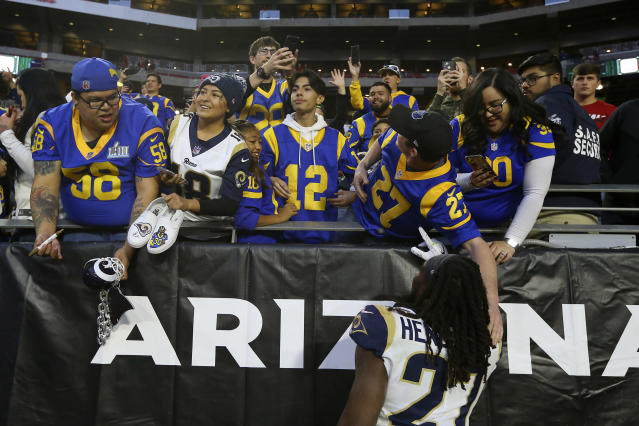 Los Angeles Rams running back Darrell Henderson (27) greets fans after an NFL football game against the Arizona Cardinals, Sunday, Dec. 1, 2019, in Glendale, Ariz. The Rams won 34-7. (AP Photo/Ross D. Franklin)