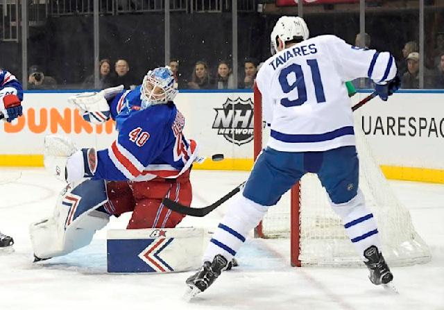 """NEW YORK — After his team allowed 56 shots on goal, Rangers coach David Quinn thought the defence was pretty good.He had Alexandar Georgiev to thank for that.Georgiev had a career-high 55 saves to lead New York over the Toronto Maple Leafs 4-1 on Sunday night. Georgiev had the second-most saves in a regular-season game in franchise history. Mike Richter has the record with 59 on Jan. 31, 1991.""""He played outstanding. He's getting better and better,"""" Quinn said of his second-year goalie on his 23rd birthday.""""It was a special birthday,"""" Georgiev said. """"I tried not to concentrate on the birthday wishes. I knew I had an important game in front of me. I'm very happy it ended the way it ended.""""Mika Zibanejad, Jimmy Vesey and Adam McQuaid scored for the Rangers, who finished their five-game homestand at 2-2-1.""""Sometimes you need a performance like this and he came up big for us, gave us a chance,"""" Zibanejad said of Georgiev.Kevin Hayes added an empty-netter, and Mats Zuccarello and Chris Kreider each had two assists.Kasperi Kapanen scored for the Maple Leafs, who had their four-game winning streak snapped.""""We played a pretty good game,"""" Kapanen said. """"Their goalie made 55 saves. He played a tremendous game. That's just hockey.""""Toronto had a season-high 56 shots, forcing Georgiev to be at his best throughout. He is the seventh goalie in franchise history with 50 or more saves in a game. The previous goalie to do it was Henrik Lundqvist last year — also on his birthday.The Rangers penalty killers also helped to slow down the Maple Leafs. Toronto went 0 for 4 on the power play despite managing 23 shots.""""I actually thought we defended pretty well,"""" Quinn said. """"That's a scary, scary team. I mean they have high-end talent. They can beat you 1-on-1, but boy I thought we did a good job clearing the net front out. They didn't have many second chances.""""Leading 2-1 in the third period, McQuaid gave the Rangers some insurance when he scored from the point at 11:59 for his second goal """