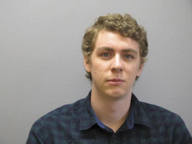 "FILE - This Sept. 6, 2016 file photo released by the Greene County Sheriff's Office, shows Brock Turner at the Greene County Sheriff's Office in Xenia, Ohio, where he officially registered as a sex offender. The woman who read a searing statement at the sentencing of the college swimmer who sexually assaulted her at Stanford University, causing a public outcry that led to the judge in the case being recalled, has revealed her identity. For years, Chanel Miller was known in legal proceedings as ""Emily Doe."" She identifies herself in a memoir, ""Know My Name,"" scheduled to be released Sept. 24. The Associated Press does not usually identify victims of sex crimes, but Miller has identified herself. (Greene County Sheriff's Office via AP, File)"