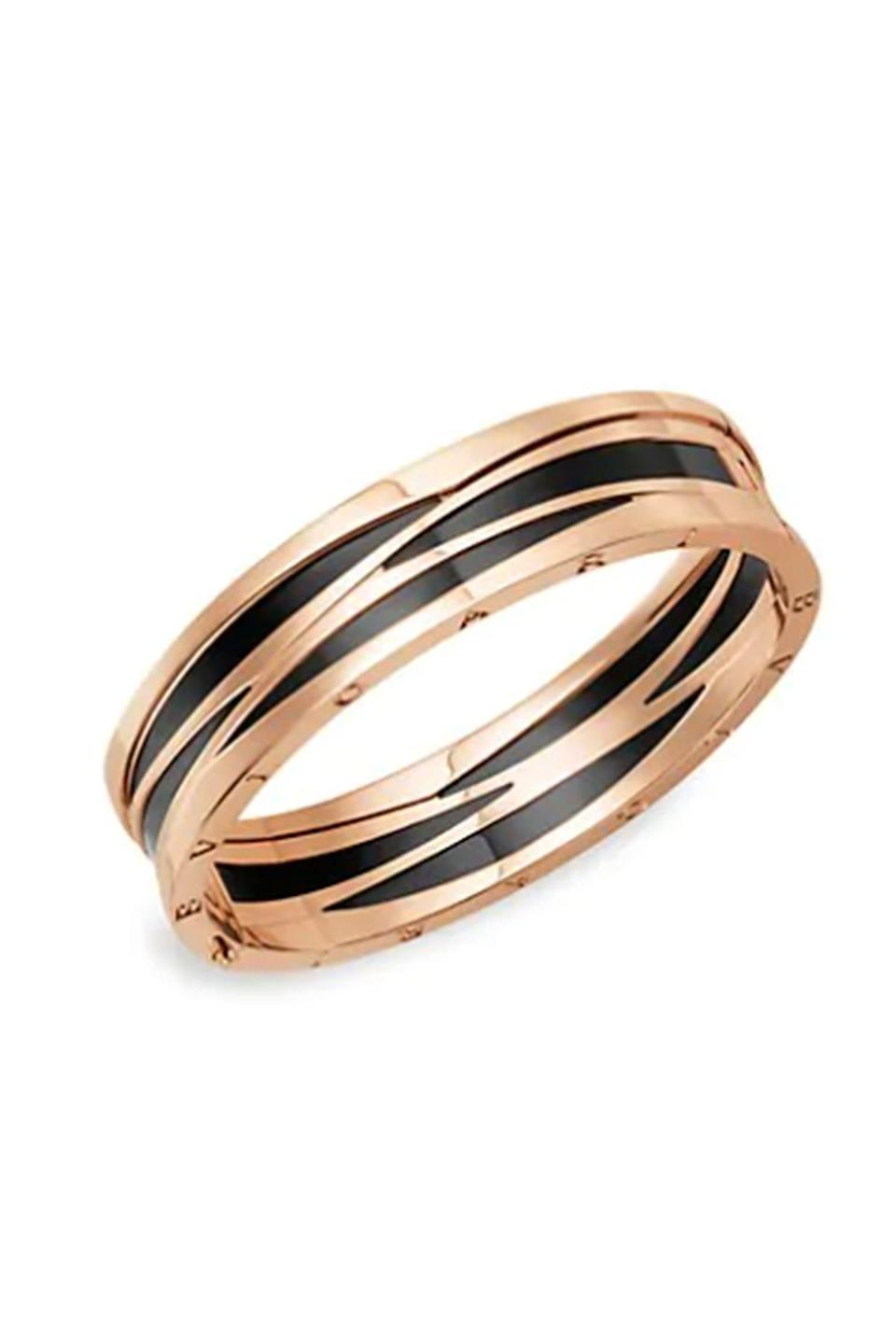 """<p><strong>Bvlgari</strong></p><p>saksfifthavenue.com</p><p><strong>$11800.00</strong></p><p><a href=""""https://go.redirectingat.com?id=74968X1596630&url=https%3A%2F%2Fwww.saksfifthavenue.com%2Fproduct%2Fbvlgari-b.zero1-design-legend-18k-rose-gold--amp--black-ceramic-hinged-bangle-bracelet-0400010715356.html%3Fdwvar_0400010715356_color%3DROSE%2BGOLD&sref=https%3A%2F%2Fwww.townandcountrymag.com%2Fstyle%2Fjewelry-and-watches%2Fg35016765%2Fbest-bracelets-for-women%2F"""" rel=""""nofollow noopener"""" target=""""_blank"""" data-ylk=""""slk:Shop Now"""" class=""""link rapid-noclick-resp"""">Shop Now</a></p><p>If you want to make a statement, this rose gold and black ceramic bracelet by Bulgari will do the trick.</p>"""