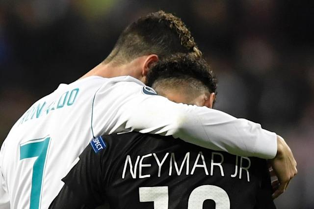 Cristiano Ronaldo consoled Neymar as 12-time European champions Real Madrid beat Paris Saint-Germain 3-1 in the first leg of their last-16 tie in the Champions League (AFP Photo/GABRIEL BOUYS )