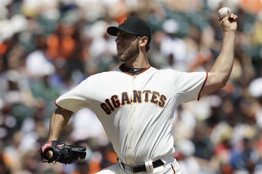 San Francisco Giants pitcher Madison Bumgarner pitches against the Milwaukee Brewers during the first inning of a baseball game in San Francisco, Saturday, May 5, 2012. (AP Photo/Jeff Chiu)