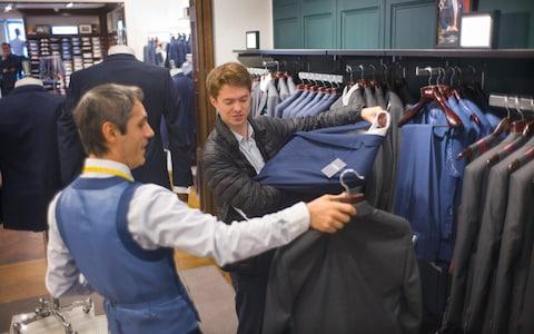 Francis examines a jacket - Credit: David Rose