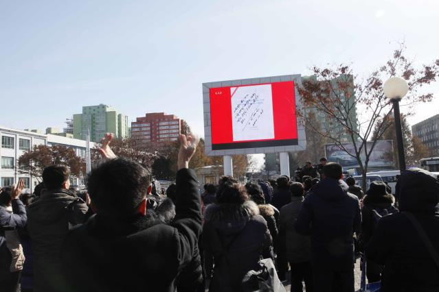 A news broadcast screened at Pyongyang Station shows Kim Jong Un's signed order to test-fire the newly developed intercontinental ballistic missile. (Photo: Jon Chol Jin/AP)