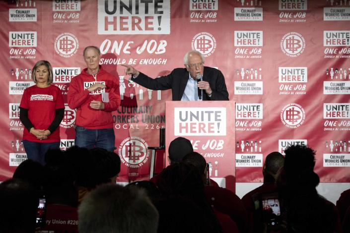 Bernie Sanders with Geoconda Argüello-Kline, left, secretary-treasurer of the Culinary Workers Union, and D. Taylor, president of Unite Here, in December 2019. (Krystal Ramirez/Las Vegas Sun via AP)