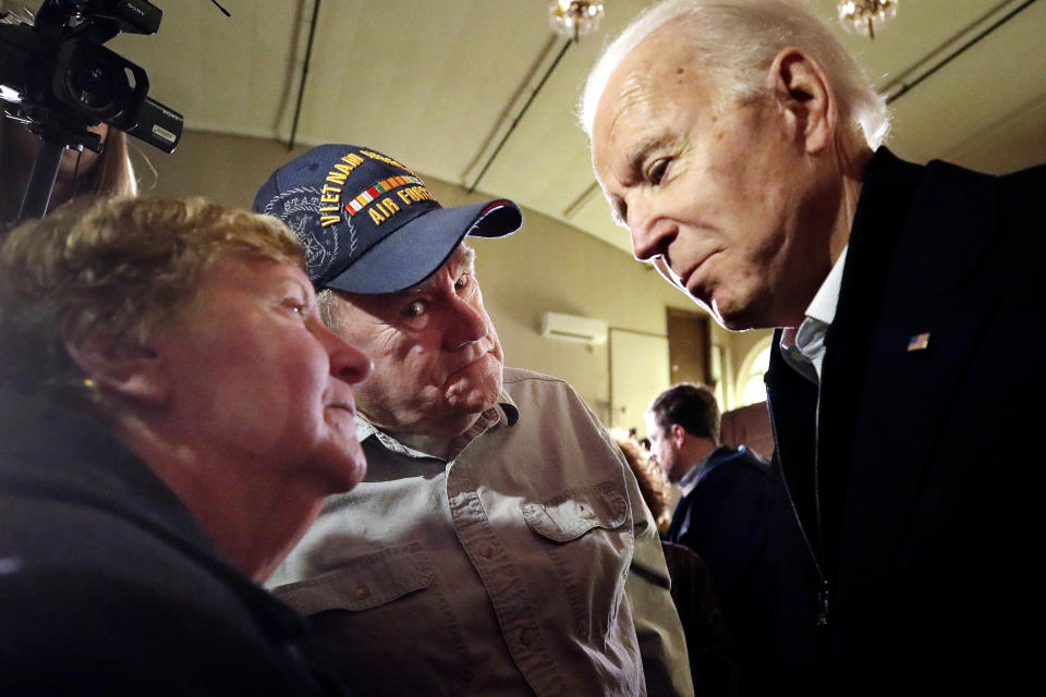 Democratic presidential candidate former Vice President Joe Biden speaks to Barbara and James Graham of Rochester, N.H. at a campaign event, Wednesday, Feb. 5, 2020, in Somersworth, N.H. (Elise Amendola/AP)