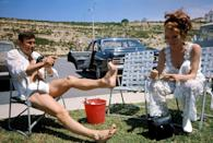 <p>George Lazenby and Diana Rigg relax on the set of the James Bond film 'On Her Majesty's Secret Service', 1969. </p>