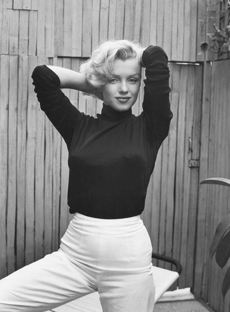 The actress poses in a black turtleneck at her home in 1953.