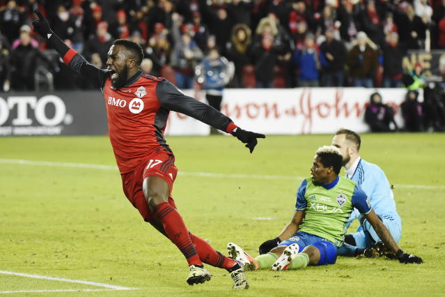 "<a class=""link rapid-noclick-resp"" href=""/soccer/teams/toronto-fc/"" data-ylk=""slk:Toronto FC"">Toronto FC</a> forward <a class=""link rapid-noclick-resp"" href=""/soccer/players/jozy-altidore/"" data-ylk=""slk:Jozy Altidore"">Jozy Altidore</a> (17) celebrates after scoring against Seattle Sounders goalkeeper <a class=""link rapid-noclick-resp"" href=""/soccer/players/stefan-frei/"" data-ylk=""slk:Stefan Frei"">Stefan Frei</a>, right, as defender <a class=""link rapid-noclick-resp"" href=""/soccer/players/joevin-jones/"" data-ylk=""slk:Joevin Jones"">Joevin Jones</a> looks on during second-half MLS Cup final soccer action in Toronto, Saturday, Dec. 9, 2017. (Nathan Denette/The Canadian Press via AP)"