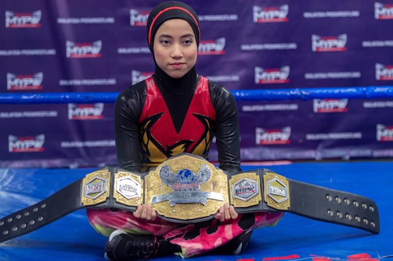 Nor 'Phoenix' Diana poses with her Wrestlecon Championship belt. — Picture by Mukhriz Hazim