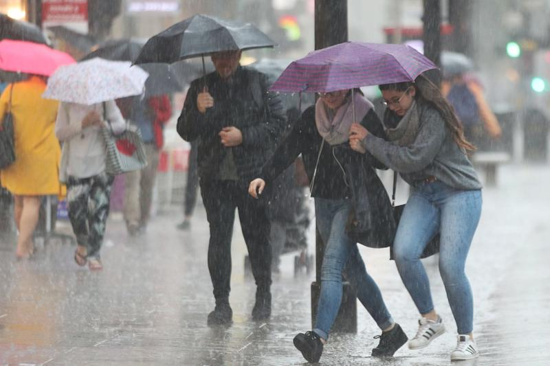 Stormy weather: People caught in the rain on Oxford Street, central London, earlier this week: PA