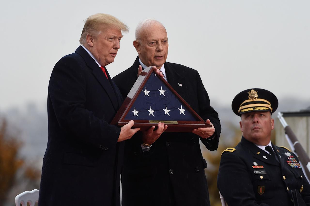 <p>President Donald Trump (L) and Major General and ABMC (American Battle Monuments Commission) Secretary William M. Matz take part in a U.S. ceremony at the American Cemetery of Suresnes, outside Paris, on Nov. 11, 2018 as part of Veterans Day and commemorations marking the 100th anniversary of the 11 November 1918 armistice, ending World War I. (Photo: Saul Loeb/AFP/Getty Images) </p>