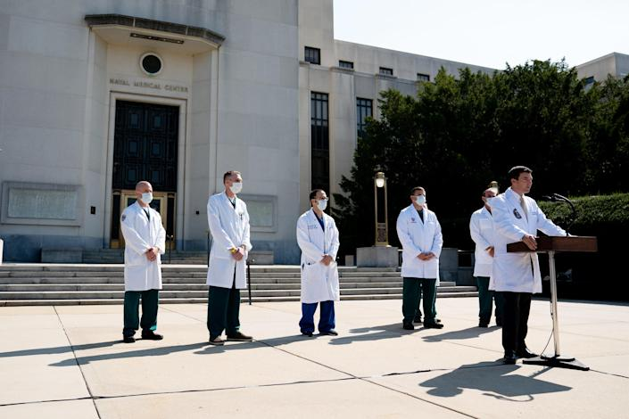 President Donald Trump's physician, Dr. Sean Conley, accompanied by other medical staff members, briefing reporters outside of Walter Reed National Military Medical Center in Bethesda Md., on Oct. 4, 2020. (Anna Moneymaker/The New York Times)