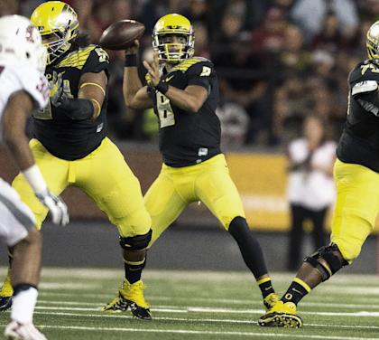 Oregon's Marcus Mariota threw for 329 yards and five TDs to keep himself firmly in the Heisman conversation. (AP)