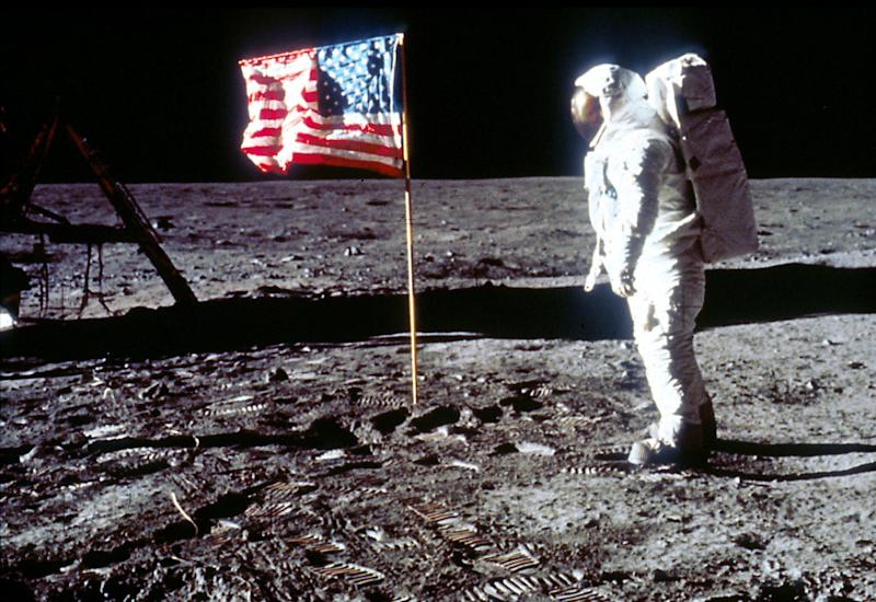Buzz Aldrin poses next to the U.S. flag July 20, 1969 on the moon during the Apollo 11 mission. (Photo by NASA/Liaison)