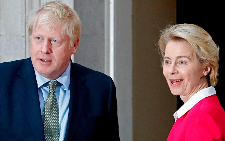 Boris Johnson with Mrs von der Leyen earlier this year.  - AFP