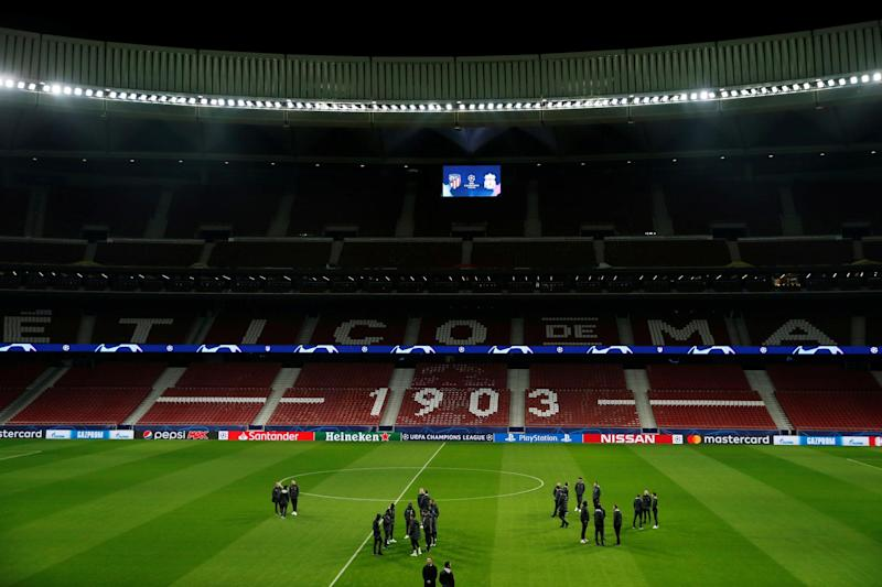 The Liverpool squad walk around the pitch at the Wanda Metropolitano ahead of their Champions League tie against Atletico Madrid Photo: Reuters