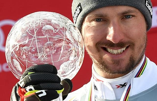 Giant Slalom World Cup overall winner Marcel Hirscher of Austria poses on the podium with his trophy after the Men's Giant Slalom event of the Alpine Skiing World Cup in Aare, Sweden, on March 17, 2018