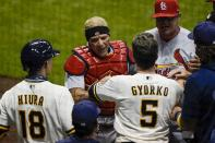 St. Louis Cardinals' Yadier Molina has words with Milwaukee Brewers' Keston Hiura and Jedd Gyorko during the fifth inning of a baseball game Tuesday, Sept. 15, 2020, in Milwaukee. (AP Photo/Morry Gash)
