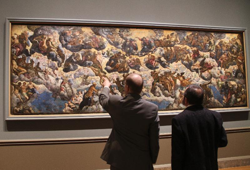 "Exhibition co-curator Robert Echols (L) points at Jacopo Tintoretto's massive oil sketch ""Paradise"" (c. 1583) at the National Gallery of Art in Washington; it was a model for a colossal piece behind the doge's throne at the Palazzo Ducale in Venice (AFP Photo/Olivia Hampton)"
