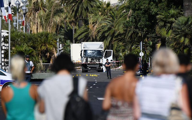 The new training and equipment has been rolled out in a response to the terrorist outrages in Nice and Berlin. Above, the lorry after the attack in Nice - Credit: CHRISTINE POUJOULAT/AFP/Getty Images